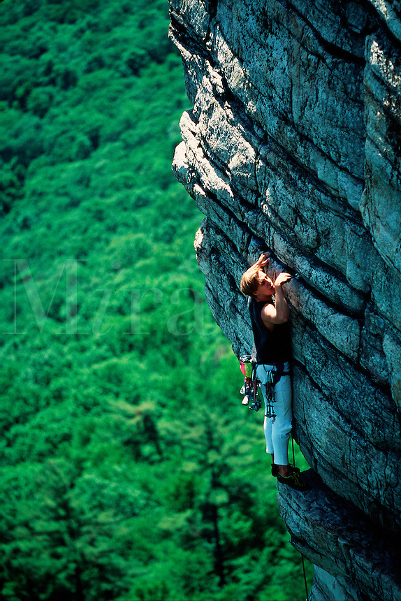 Rock climber on the route named 'High Exposure' in New York's Schwangunks climbing park. New Paltz, New York.