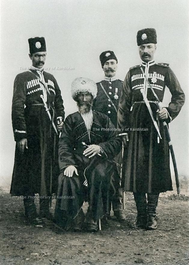 Turkey 1901 In Karakilise ( Agri today ) , Eyub Pasha seated with his son and his nephew, behind his henchman, Kurdish officers of  Hamidiyeh cavalry  Turquie 1901  A Karakilise ( Agri aujourd'hui ) assis Eyub Pasha, entouré de son fils, de son neveu et derriere de son homme de confiance , officiers kurdes de la cavalerie Hamidiyeh
