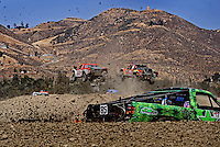 Jun. 27, 2009; Lake Elsinore, CA, USA; LOORRS unlimited 2 drivers Rodrigo Ampudia (36) jumps alongside Jerry Whelchel (2) as Kevin Davis (85) races by in the foreground during round five at the Lake Elsinore Motorsports Complex. Mandatory Credit: Mark J. Rebilas-