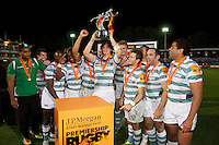 20120803 Copyright onEdition 2012©.Free for editorial use image, please credit: onEdition..Alex Gray of London Irish 7s holds up the trophy as they celebrate winning the J.P. Morgan Asset Management Premiership Rugby 7s Series at The Recreation Ground, Bath in the Final round of The J.P. Morgan Asset Management Premiership Rugby 7s Series...The J.P. Morgan Asset Management Premiership Rugby 7s Series kicked off again for the third season on Friday 13th July at The Stoop, Twickenham with Pool B being played at Edgeley Park, Stockport on Friday, 20th July, Pool C at Kingsholm Gloucester on Thursday, 26th July and the Final being played at The Recreation Ground, Bath on Friday 3rd August. The innovative tournament, which involves all 12 Premiership Rugby clubs, offers a fantastic platform for some of the country's finest young athletes to be exposed to the excitement, pressures and skills required to compete at an elite level...The 12 Premiership Rugby clubs are divided into three groups for the tournament, with the winner and runner up of each regional event going through to the Final. There are six games each evening, with each match consisting of two 7 minute halves with a 2 minute break at half time...For additional images please go to: http://www.w-w-i.com/jp_morgan_premiership_sevens/..For press contacts contact: Beth Begg at brandRapport on D: +44 (0)20 7932 5813 M: +44 (0)7900 88231 E: BBegg@brand-rapport.com..If you require a higher resolution image or you have any other onEdition photographic enquiries, please contact onEdition on 0845 900 2 900 or email info@onEdition.com.This image is copyright the onEdition 2012©..This image has been supplied by onEdition and must be credited onEdition. The author is asserting his full Moral rights in relation to the publication of this image. Rights for onward transmission of any image or file is not granted or implied. Changing or deleting Copyright information is illegal as specified in the Copyright, Design and Patents