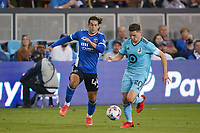 SAN JOSE, CA - AUGUST 17: Cade Cowell #44 of the San Jose Earthquakes battles for the ball with Wil Trapp #20 of Minnesota United during a game between Minnesota United FC and San Jose Earthquakes at PayPal Park on August 17, 2021 in San Jose, California.