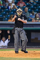 Home plate umpire Brandon Butler makes a strike call during the Midwest League game between the Quad Cities River Bandits and the Bowling Green Hot Rods at Bowling Green Ballpark on July 26, 2014 in Bowling Green, Kentucky.  The River Bandits defeated the Hot Rods 9-2.  (Brian Westerholt/Four Seam Images)