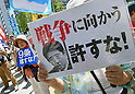 Protesters against rights to collective self-defense outside Diet building in Tokyo