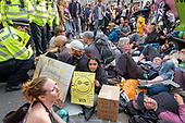 Police arrest Extinction Rebellion climate change campaigners during occupation of Oxford Circus, London.