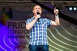 © Joel Goodman - 07973 332324 . 02/07/2011 . London , UK . CHRIS BRYANT speaks on the stage in Trafalgar Square . Tens of thousands take part in the annual Pride march in London . Photo credit : Joel Goodman