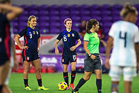 ORLANDO CITY, FL - FEBRUARY 24: Lindsey Horan #9 and Megan Rapinoe #15 of the USWNT wait for the free kick during a game between Argentina and USWNT at Exploria Stadium on February 24, 2021 in Orlando City, Florida.