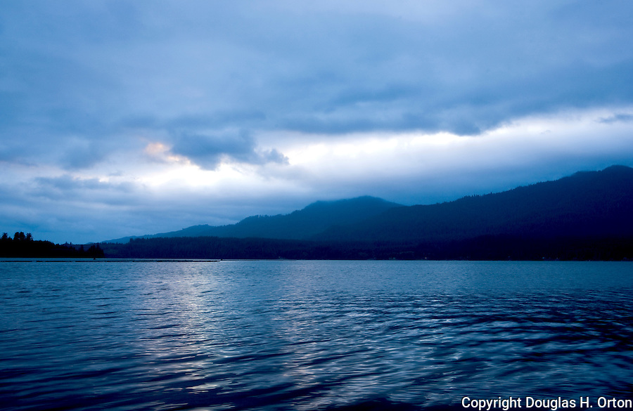 Lake Quinault lies just inland of the Pacific Ocean in Washington State, on the Olympic Penninsula.  The lake is Quinault Indian Nation. It's shores include Quinault land, Quinault National Forest, Olympic National Park, pristine rainforest, and many campgrounds.  Recreation opportunities include fishing and prime accesses to Olympic National Park hiking. Olympic Peninsula