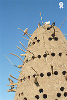 Traditional Egyptian pigeon house against clear blue sky, close-up (Licence this image exclusively with Getty: http://www.gettyimages.com/detail/200387965-001 )