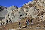 Four Caucasian women hiking towards the summit of  Mount Evans (14250 feet) in the Rocky Mountains west of Denver, Colorado. Guided photo tours and hiking tours to Mt Evans. .  John leads hiking and photo tours throughout Colorado.