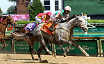 April 30, 2021 : Obligatory, #7, ridden by jockey Jose Ortiz, wins the Eight Belles Stakes on Kentucky Oaks Day at Churchill Downs on April 30, 2021 in Louisville, Kentucky. Candice Chavez/Eclipse Sportswire/CSM