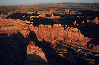 The Maze area of Canyonlands National Park in shown in and aerial in stark evening light.