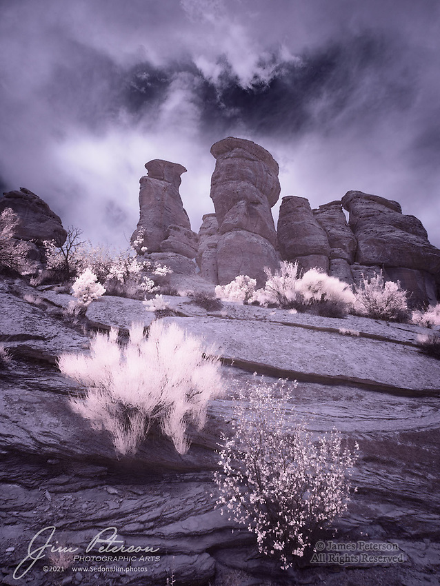 Stormy Morning along Devil's Kitchen Trail (Infrared).  If you've never been to Colorado National Monument, it belongs on your bucket list.  (I'll admit that I might be slightly biased there, inasmuch as this is the kind of territory I grew up in – and love!)  You'll find classic Southwestern sandstone cliffs and canyons there, plus plenty of overlooks and trails with spectacular views of this glorious region.  And if you happen to be there during the monsoon season and have infrared eyes, you might even see something like this.<br /> <br /> Tech info: Nikon D3200 camera (modified for infrared with 590nm filter), Nikon 10-24mm lens at 13mm, 1/200 sec. at f16, ISO 200.<br /> <br /> Image ©2021 James D Peterson