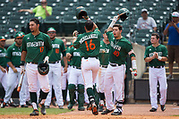 Edgar Michelangeli (16) of the Miami Hurricanes is greeted by his teammates after hitting a solo home run against the Wake Forest Demon Deacons in Game Nine of the 2017 ACC Baseball Championship at Louisville Slugger Field on May 26, 2017 in Louisville, Kentucky.  The Hurricanes defeated the Demon Deacons 5-2 to advance to the semi-finals.  (Brian Westerholt/Four Seam Images)