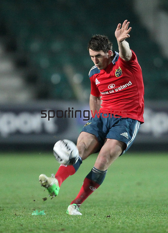 Fly-half Ian Keatley of Munster Rugby kicks a successful conversion.<br /> <br /> Guiness Pro 12<br /> Newport Gwent Dragons v Munster Rugby<br /> Rodney Parade<br /> 21.11.14<br /> ©Steve Pope-SPORTINGWALES
