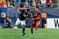 FOXBOROUGH, MA - SEPTEMBER 21: DeJuan Jones #24 of New England Revolution attempts to control the ball as Sebastian Saucedo #23 of Real Salt Lake defends during a game between Real Salt Lake and New England Revolution at Gillette Stadium on September 21, 2019 in Foxborough, Massachusetts.