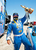 Jul 12, 2020; Clermont, Indiana, USA; NHRA funny car driver Matt Hagan celebrates after winning the E3 Spark Plugs Nationals at Lucas Oil Raceway. This is the first race back for NHRA since the start of the COVID-19 global pandemic. Mandatory Credit: Mark J. Rebilas-USA TODAY Sports