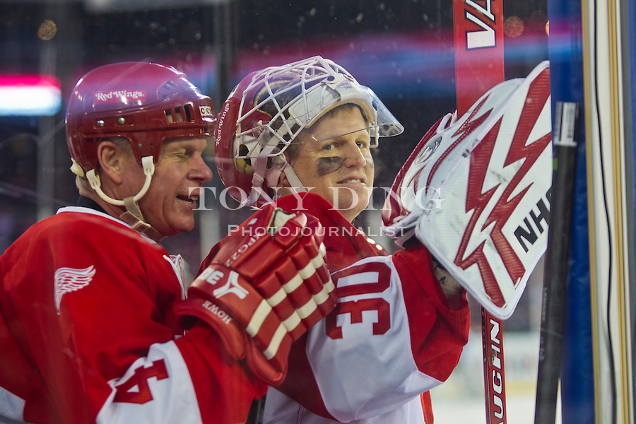 31 December 2013: Former Detroit Red Wings defenseman Mark Howe (4) chats with goalie Chris Osgood (30) on the bench during the Toronto Maple Leafs v Detroit Red Wings Alumni Showdown hockey game, at Comerica Park, in Detroit, MI.