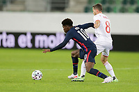 ST. GALLEN, SWITZERLAND - MAY 30: Yunus Musah #10  of the United States chases down a loose ball during a game between Switzerland and USMNT at Kybunpark on May 30, 2021 in St. Gallen, Switzerland.