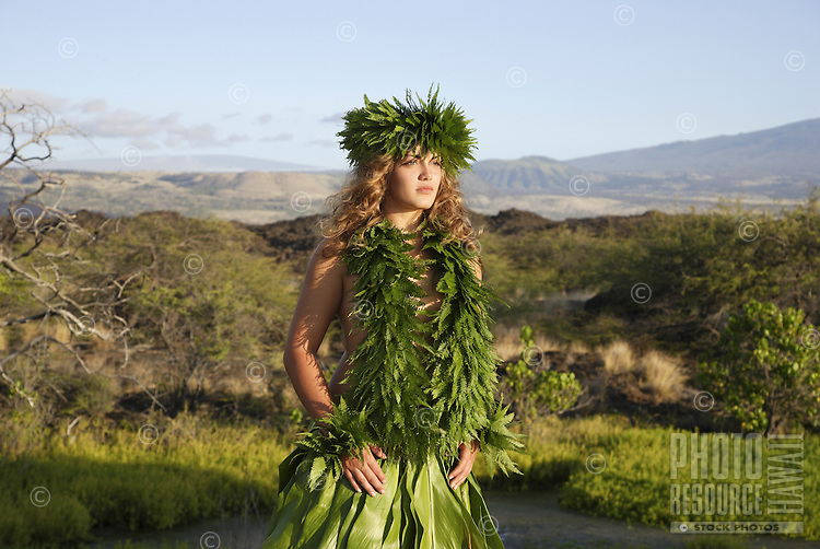 Female (wahine) hula dancer deep in thought, wearing palapalai fern head lei, headshot.