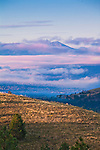 Lolo Peak rises above the clouds on the southern edge of Missoula, Montana