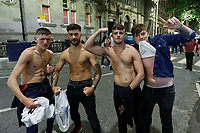 Pictured: Four young men take their tops off in Wind Street, Swansea, Wales, UK. Saturday 07 August 2021<br /> Re: Nightclubs have reopened this weekend as most Covid restrictions have come to an end in Wales, UK.<br /> Pubs and restaurants were allowed to open for certain periods, with safety measures in place unlike nightclubs.