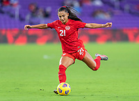 ORLANDO, FL - FEBRUARY 21: Jordyn Listro #21 of Canada passes the ball during a game between Canada and Argentina at Exploria Stadium on February 21, 2021 in Orlando, Florida.