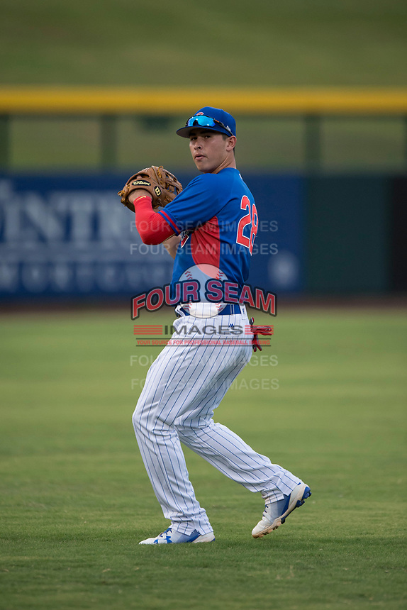 AZL Cubs 2 left fielder Carlos Pacheco (28) warms up between innings of an Arizona League game against the AZL Rangers at Sloan Park on July 7, 2018 in Mesa, Arizona. AZL Rangers defeated AZL Cubs 2 11-2. (Zachary Lucy/Four Seam Images)