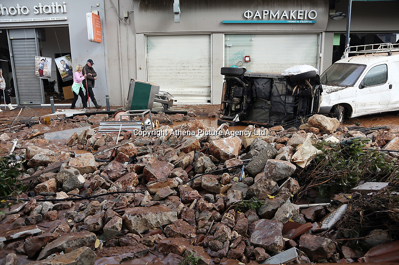 Pictured: Debris and cars on the road.<br /> Re: Five people have reportedly died and severe damage caused by heavy rain and flash flooding in the area of Mandra, near Athens, Greece. Wednesday 15 November 2017