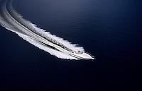 Speed boat glides through ocean water.