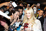 """Elle Fanning, Jun 23, 2014 : Tokyo, Japan : The actress Elle Fanning takes a pictures with fans during the Japan premier for the film """"Maleficent"""" in Yebisu Garden Place on June 23, 2014. The movie will be released on July 5th. (Photo by Rodrigo Reyes Marin/AFLO)"""