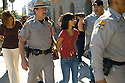 """Protesting the SB1611 at the State Capitol in Phoenix, AZ A mother (Alma Sotelo cq) and her 15 year old Daughter are arrested for chanting """"No Mas"""" during the hearing while State Senator Kyrsten Sinema (cq) was speaking on Tuesday, February 22, 2011..Photo by AJ Alexander"""