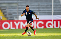 GUADALAJARA, MEXICO - MARCH 28: Aaron Herrera #17 of the United States races with the ball during a game between Honduras and USMNT U-23 at Estadio Jalisco on March 28, 2021 in Guadalajara, Mexico.
