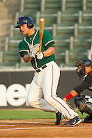 Kyle Jensen #22 of the Greensboro Grasshoppers follows through on his swing against the Kannapolis Intimidators at Fieldcrest Cannon Stadium August 2, 2010, in Kannapolis, North Carolina.  Photo by Brian Westerholt / Four Seam Images