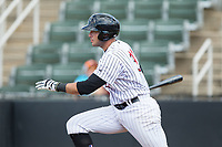 Brandon Dulin (31) of the Kannapolis Intimidators follows through on his swing against the West Virginia Power at Kannapolis Intimidators Stadium on June 18, 2017 in Kannapolis, North Carolina.  The Intimidators defeated the Power 5-3 to win the South Atlantic League Northern Division first half title.  It is the first trip to the playoffs for the Intimidators since 2009.  (Brian Westerholt/Four Seam Images)
