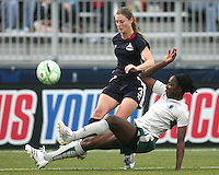 Jill Gilbeau #3 of the Washington Freedom is tackled by Tina Ellerton #8 of St. Louis Athletica during a WPS match at the Maryland Soccerplex on May 3, 2009 in Boyds Maryland. The game ended in a 3-3 tie.