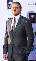 "[(FILE) Actor Charlie Hunnam has dropped out of the lead role of character Christian Grey in the ""Fifty Shades of Grey"" (2014) film adaptation. ""The filmmakers of 'Fifty Shades of Grey' and Charlie Hunnam have agreed to find another male lead given Hunnam's immersive TV schedule which is not allowing him time to adequately prepare for the role of Christian Grey,"" Universal Pictures said in a statement, obtained by The Hollywood Reporter.] HOLLYWOOD, CA - SEPTEMBER 07: Actor Charlie Hunnam at the Premiere Of FX's ""Sons Of Anarchy"" Season 6 held at the Dolby Theatre on September 7, 2013 in Hollywood, California. (Photo by Rudy Torres/Celebrity Monitor)"