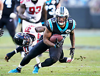 CHARLOTTE, NC - NOVEMBER 17: D.J. Moore #12 of the Carolina Panthers runs with the ball during a game between Atlanta Falcons and Carolina Panthers at Bank of America Stadium on November 17, 2019 in Charlotte, North Carolina.