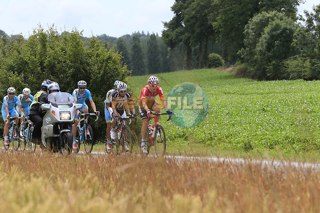 The peleton pass through rural landscape near Bemont during Stage 4 of the 2014 Tour de France running 163.5km from Le Touquet to Lille. 8th July 2014.<br /> Picture: Eoin Clarke www.newsfile.ie