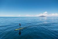 Standup paddle-boarder on Lake Titicaca, Peru