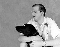 Illustration<br /> A Visually handicapped man pose with his eye seeing dog in a studio picture<br /> <br /> Photo by Pierre Roussel