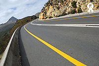 Curved highway road and yellow line (Licence this image exclusively with Getty: http://www.gettyimages.com/detail/100378212 )