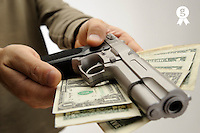 Man offering money and gun (Licence this image exclusively with Getty: http://www.gettyimages.com/detail/84430576 )