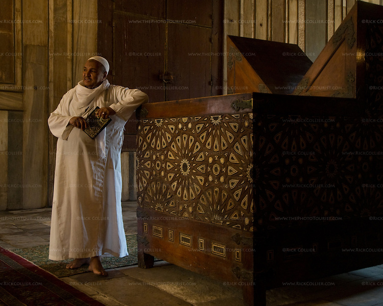 Cairo, Egypt -- A cleric describes history and religious practice within the mausoleum of the Sultan Hassan mosque.  (Subject permission / release is available.) © Rick Collier / RickCollier.com.
