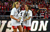 Orlando, FL - Saturday October 14, 2017: Allie Long, Tobin Heath and the Portland Thorns FC celebrate their National Women's Soccer League (NWSL) Championship win by defeating North Carolina Courage 1-0 during the NWSL Championship match between the North Carolina Courage and the Portland Thorns FC at Orlando City Stadium.