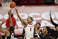 Arkansas guard JD Notae (1) drives the ball for a layup, Saturday, January 9, 2021 during the first half of a basketball game at Bud Walton Arena in Fayetteville. Check out nwaonline.com/210110Daily/ for today's photo gallery. <br /> (NWA Democrat-Gazette/Charlie Kaijo)