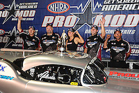 Jun. 19, 2011; Bristol, TN, USA: NHRA pro mod driver Melanie Troxel celebrates with her crew after winning at the Thunder Valley Nationals at Bristol Dragway. Mandatory Credit: Mark J. Rebilas-US