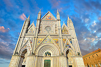 14th century Tuscan Gothic style facade of the Cathedral of Orvieto, designed by Maitani , Umbria, Italy