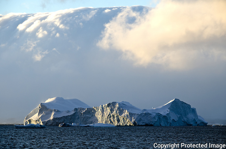 A lonly Iceberg over the Bellinghausen sea in Antarctica peninsula, during summer the light can be magnificent for photography.