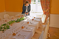 The table set for lunch and wine tasting for visitors and a waitress at a sunny window - Chateau Belgrave, Haut-Medoc, Grand Crus Classe 1855
