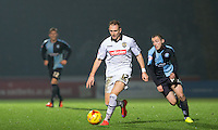 Michael Harriman of Wycombe Wanderers closes down Robert Milsom of Notts County during the Sky Bet League 2 match between Wycombe Wanderers and Notts County at Adams Park, High Wycombe, England on 15 December 2015. Photo by Andy Rowland.